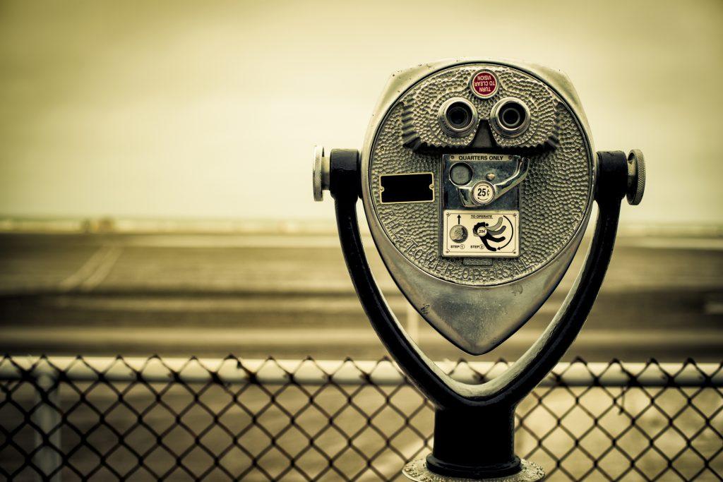 tourist retro coin operated binoculars on the beach